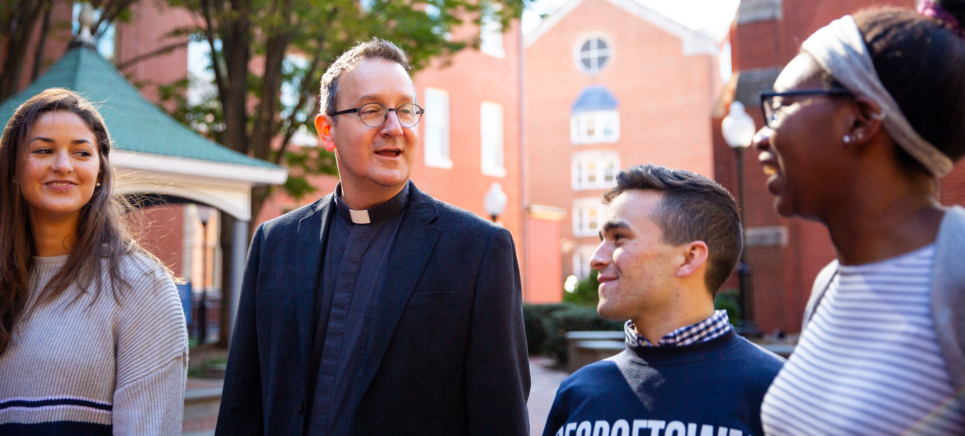 Father Bosco with students outside Dahlgren Chapel