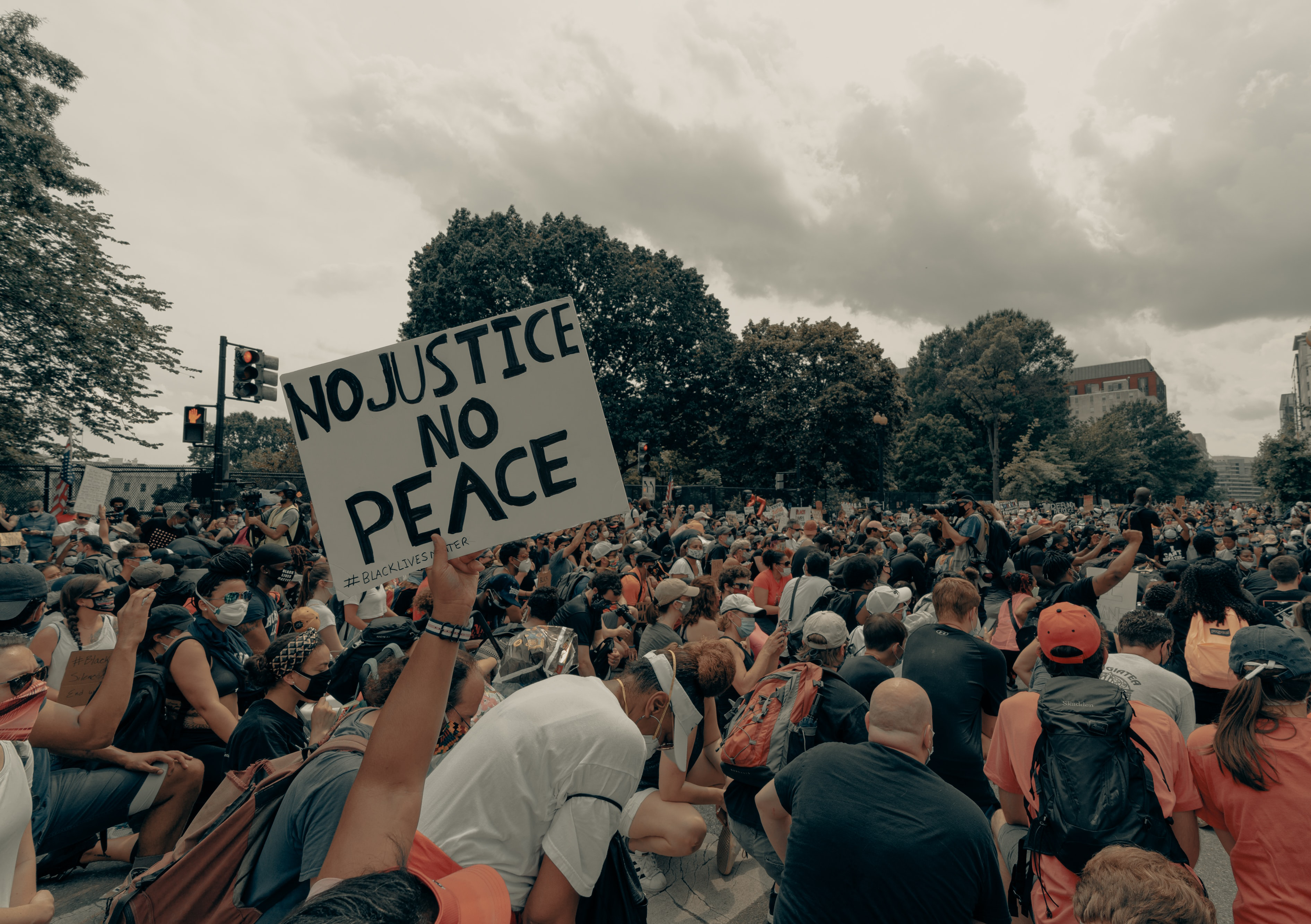 Photo by Clay Banks, Unsplash, group of people kneeling at protest