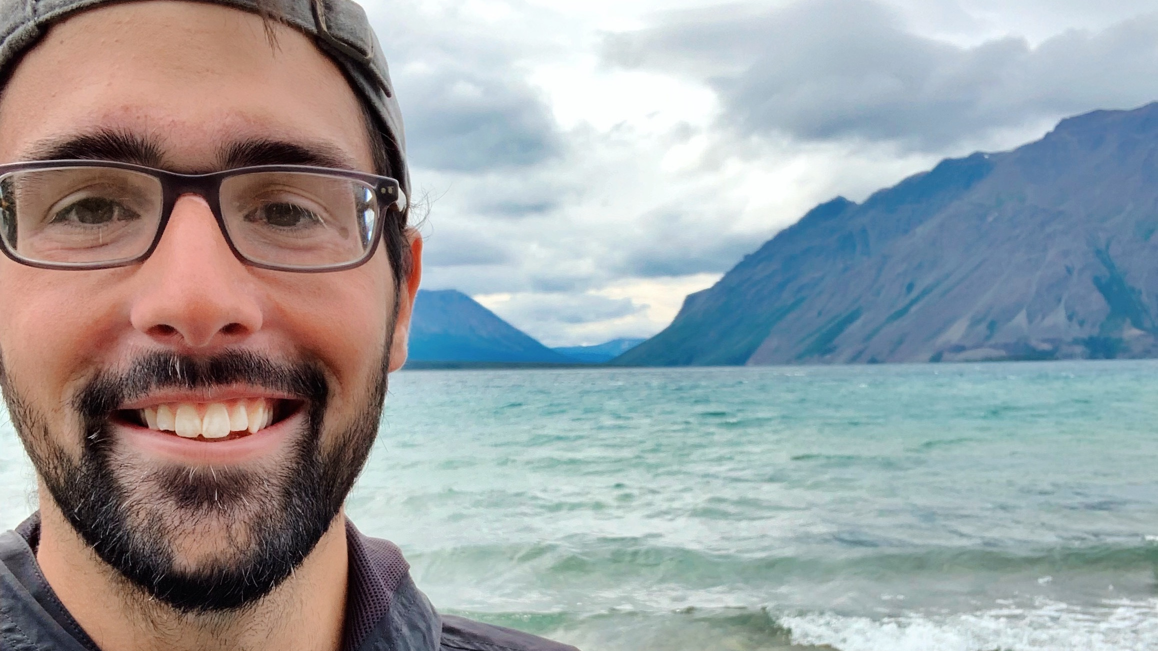 Vaughn Shirey selfie on beach with mountains