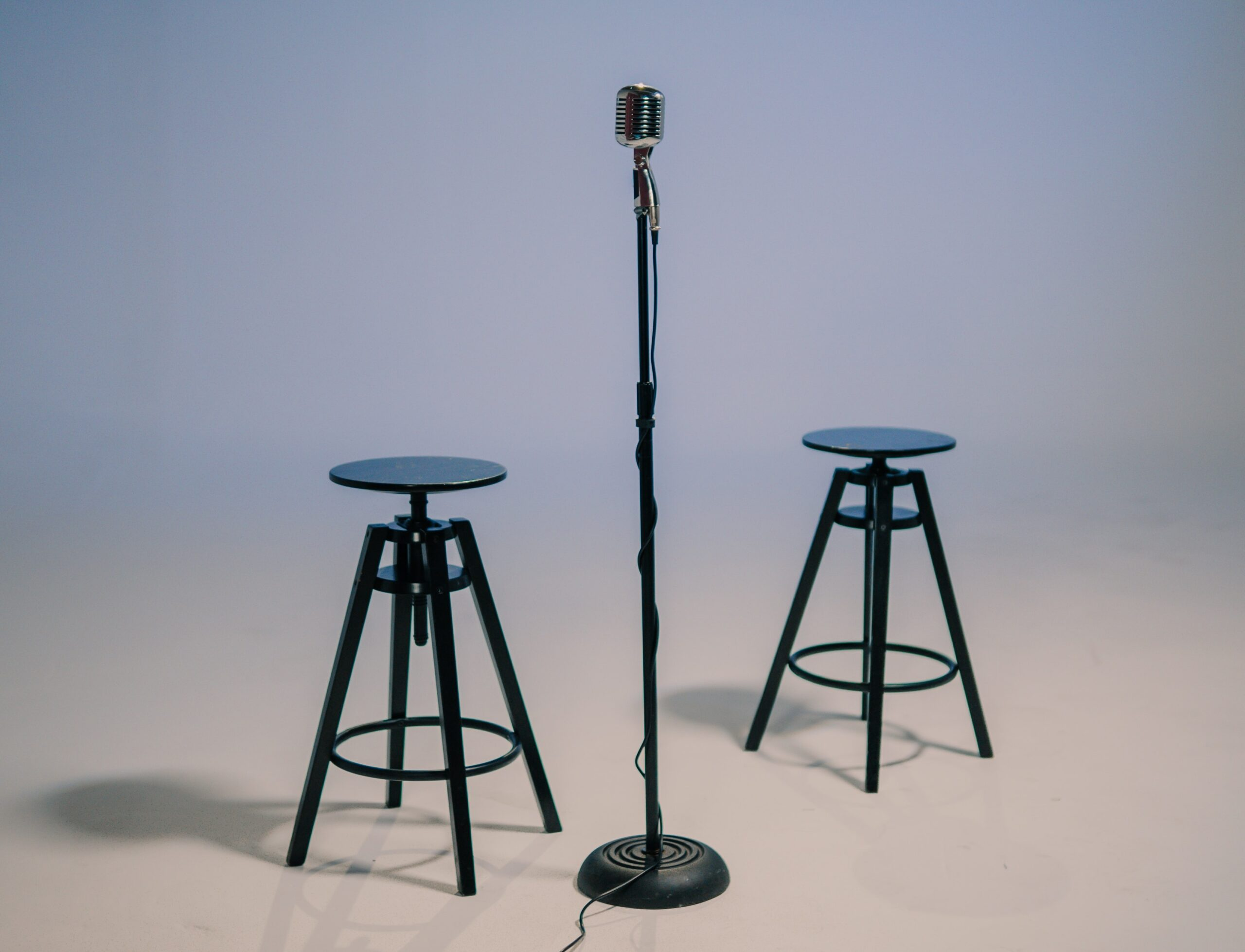 two chairs in front of a microphone