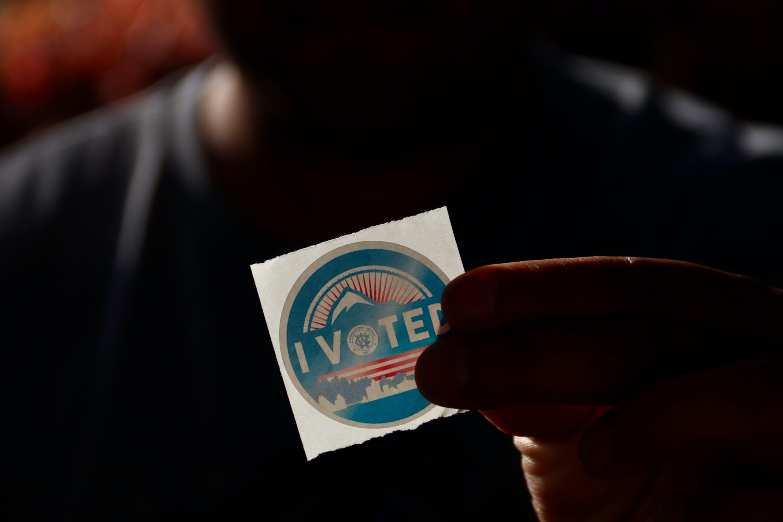 Photo of hand with I Voted sticker