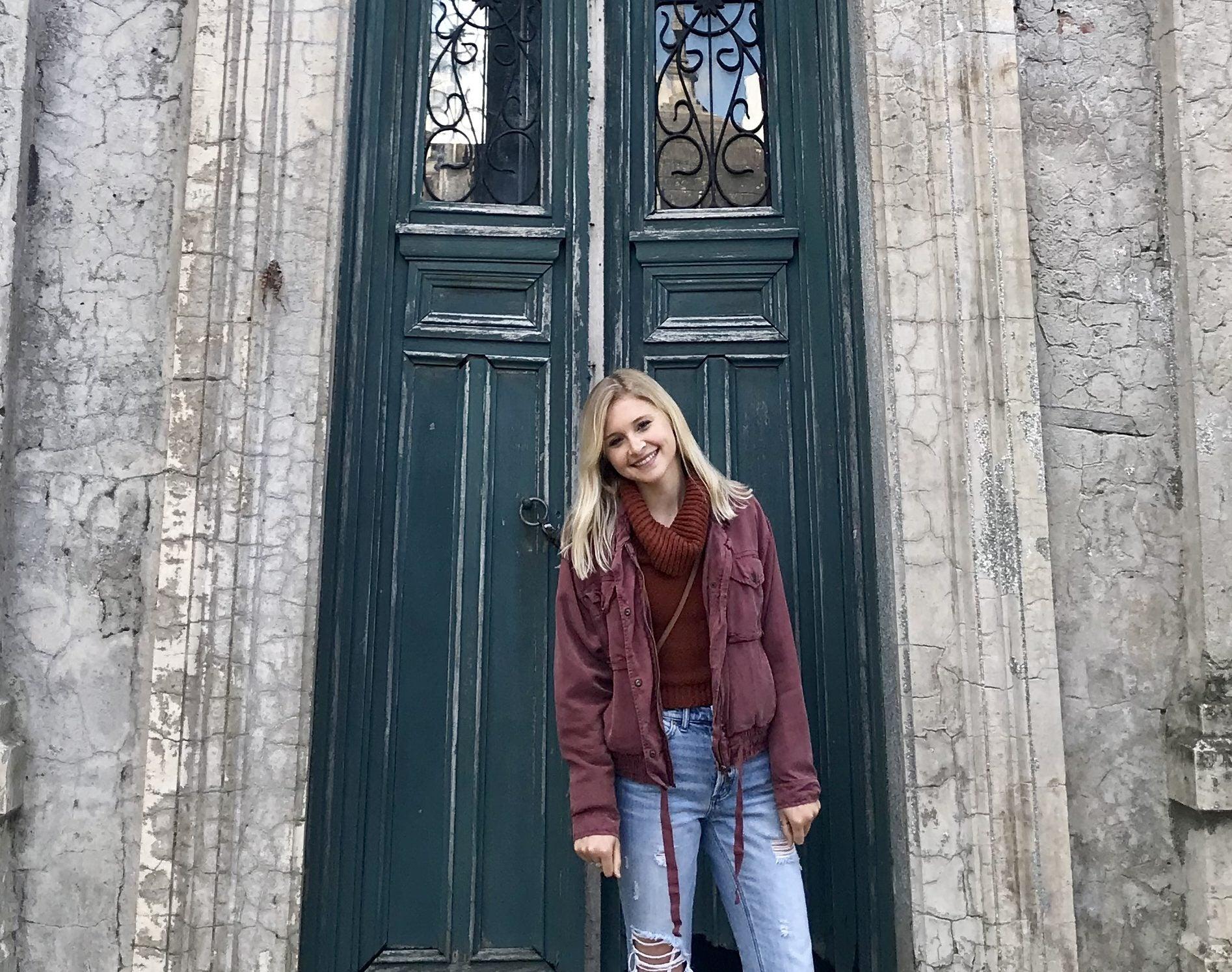 Grace Keegan standing in front of a door