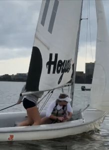 Victoria on a sailboat that says Hoyas