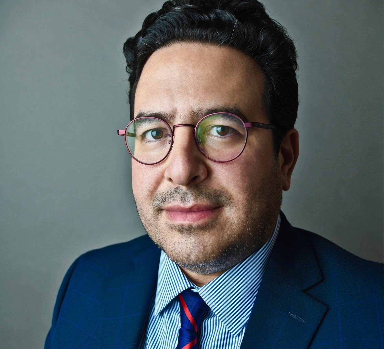 headshot of Mike Amezcua on gray background