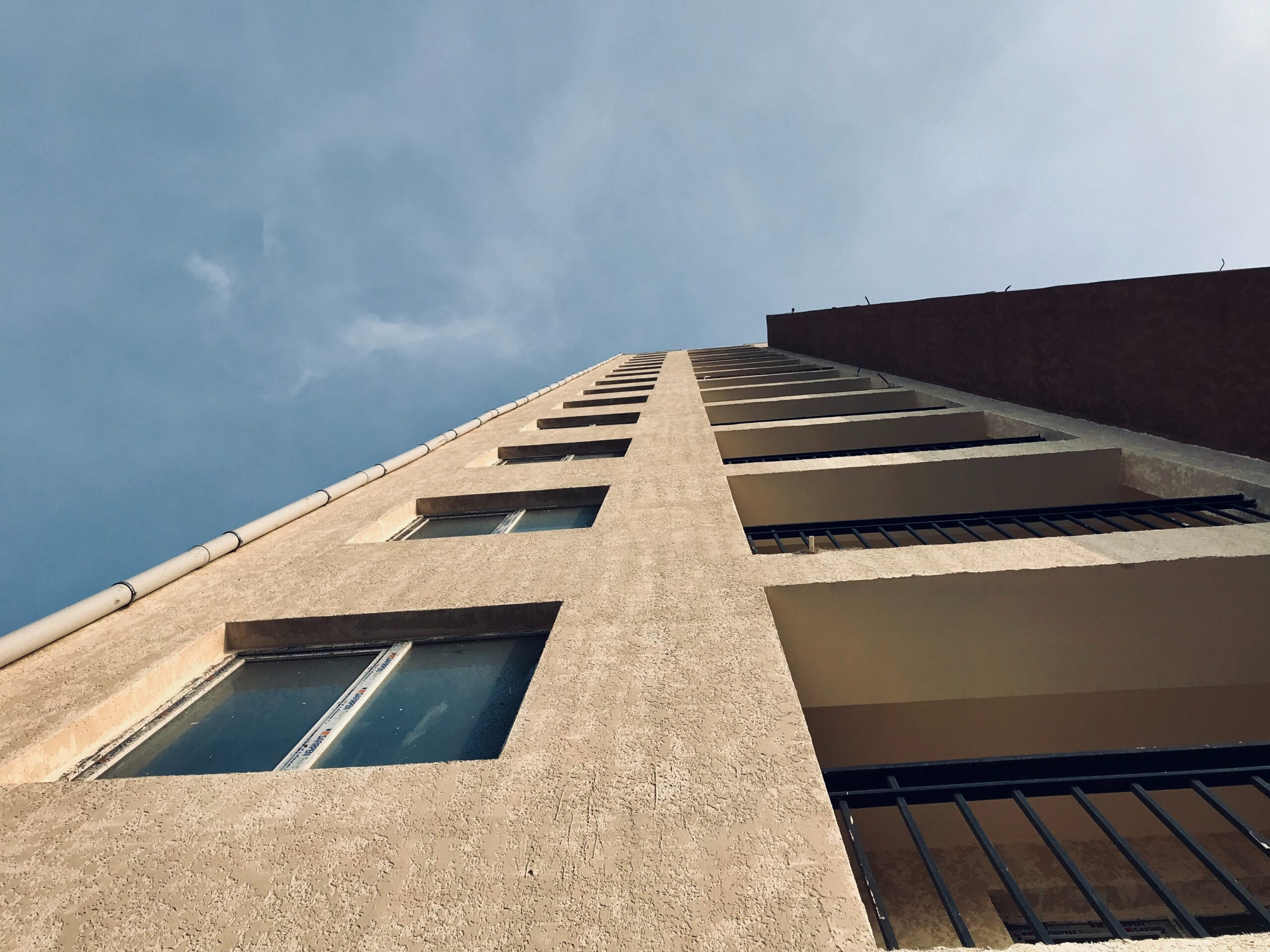 Shot of building upwards towards the sky from the ground