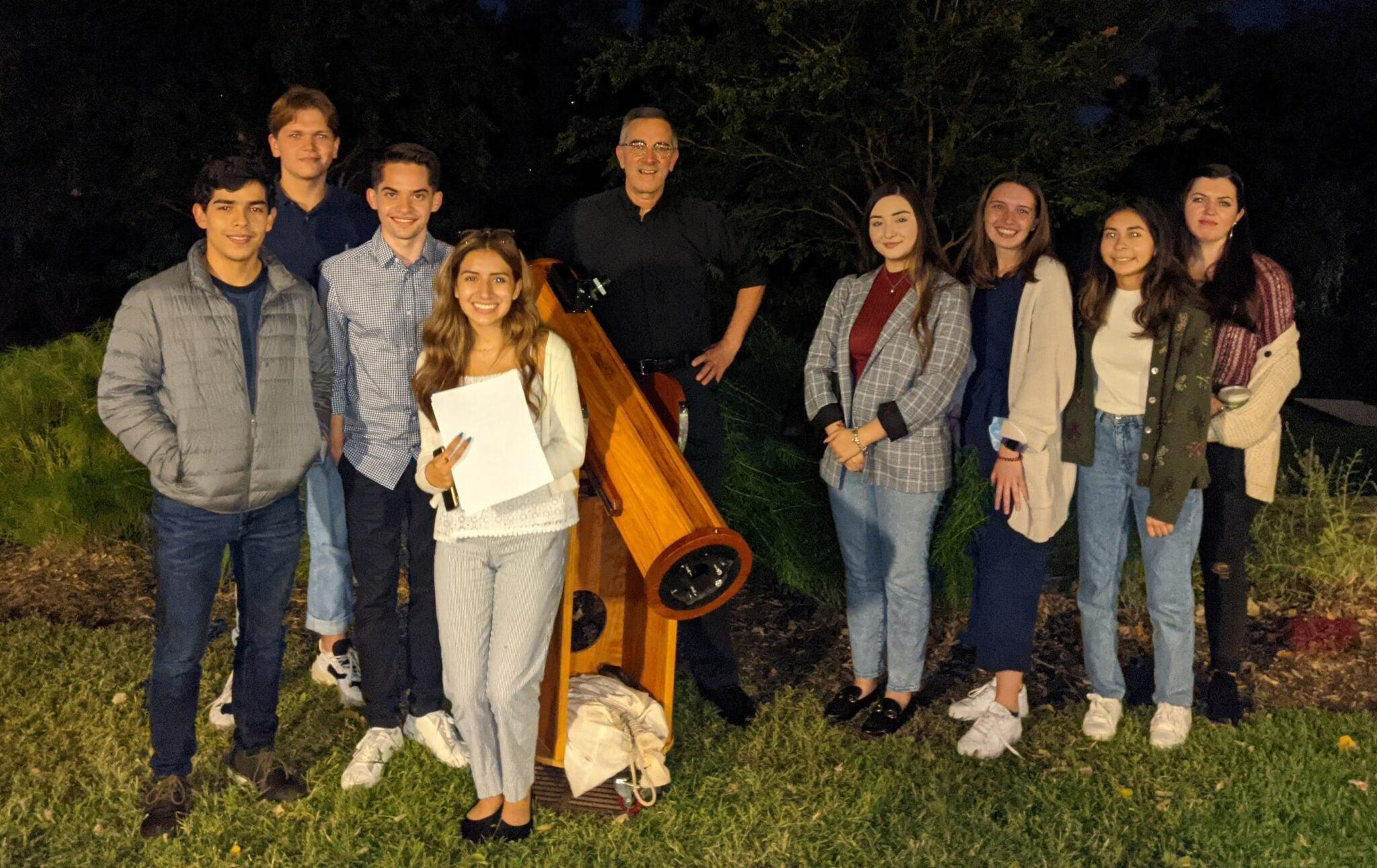After Dinner Stargazing: Rodrigo, Andrii, Juan Pablo, Mariana, Fr. Collins & his telescope, Mailí, Kenzie, Jess, Colleen